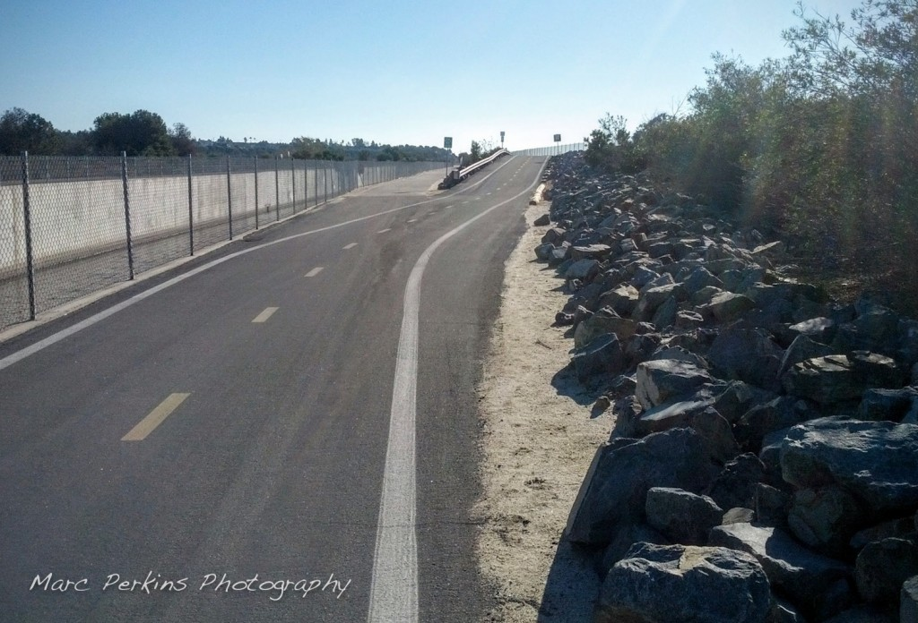 The exit to Fairview Park is just down a little slope from the fork that exits to Adams Ave. The Santa Ana River Trail continues up the slope in this image; the Fairview Park exit continues on level ground to the left.