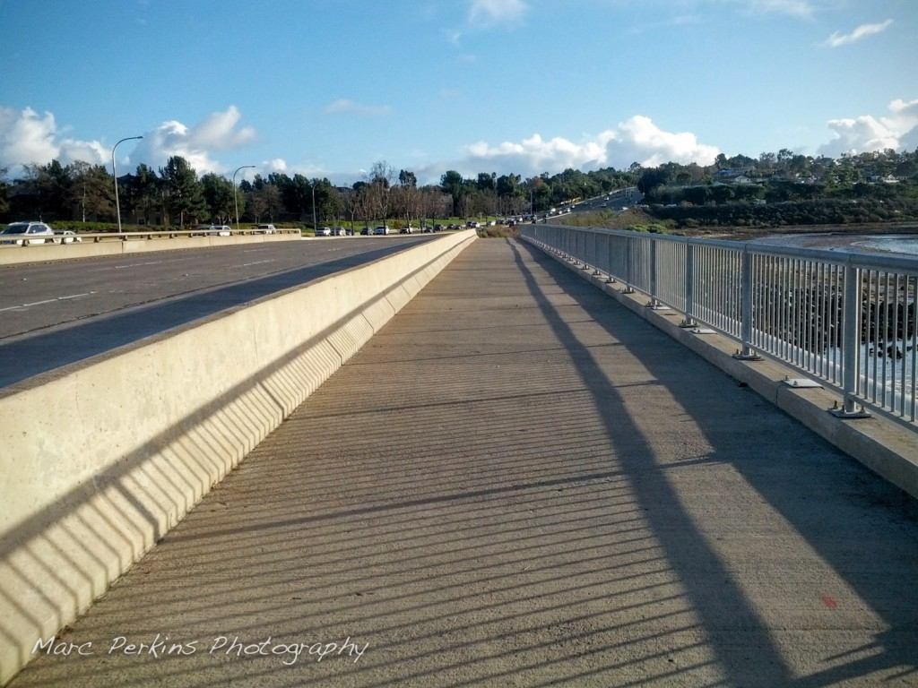 The protected pedestrian and bicycle lane on the Jamboree bridge over San Diego Creek.