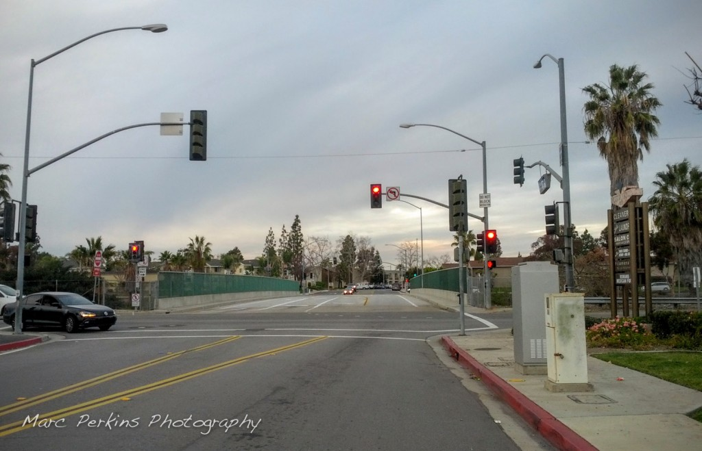 My preferred point to cross the 55 freeway / Newport Drive in this area of Costa Mesa is at Vanguard Way / Santa Isabel.
