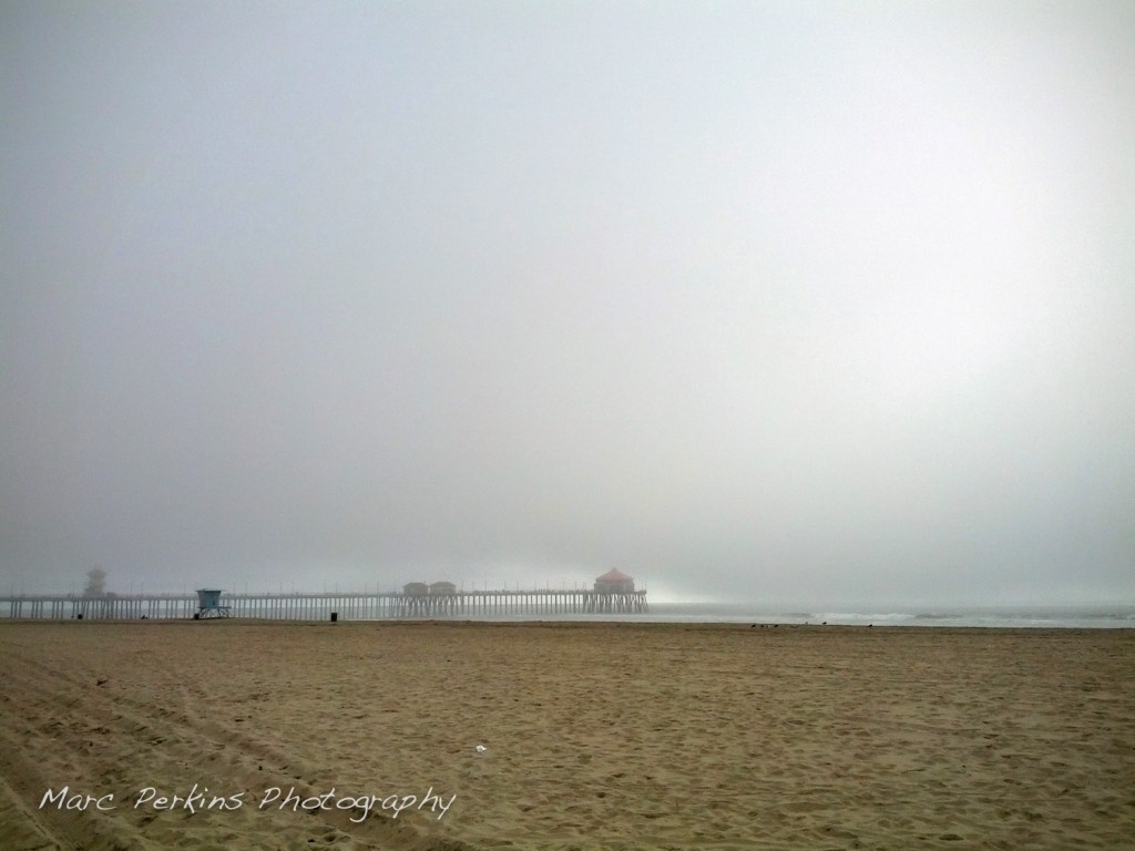 Fog arrives at the Huntington Beach Pier.