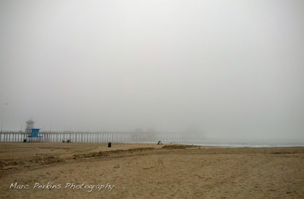 Fog shrouds the Huntington Beach Pier.