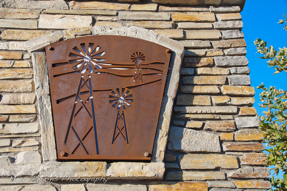 "Metallic cutouts with a windmill pattern are frequent in the Grand Ave. corridor; this one is on the large entrance sign on the eastern edge of the city. This was part of the 2015 rebuild of the Grand Avenue and Longview Drive intersection for Diamond Bar's 2015 ""Grand Avenue Beautification"" project, landscape architecture for the project was by David Volz Design."