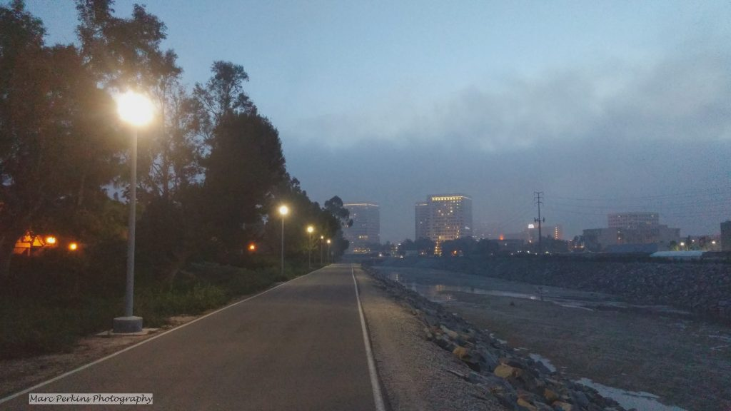 lights illuminate the fog-shrouded bike trail.