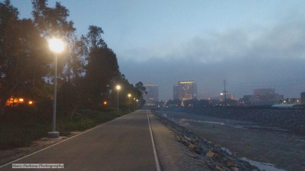 lights illuminate the fog-shrouded bike trail.