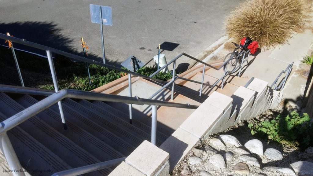 Bike at the bottom of stairs.