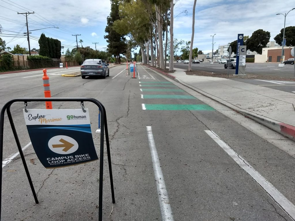 Conflict zone striping at a driveway along the Merrimac Way demonstration protected bike lane.